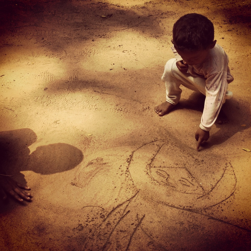 Drawing pictures in the sand