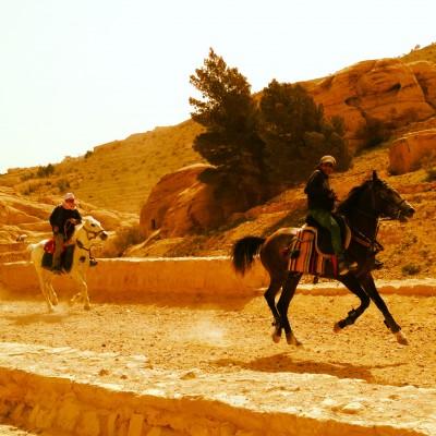 Entering Petra on horseback